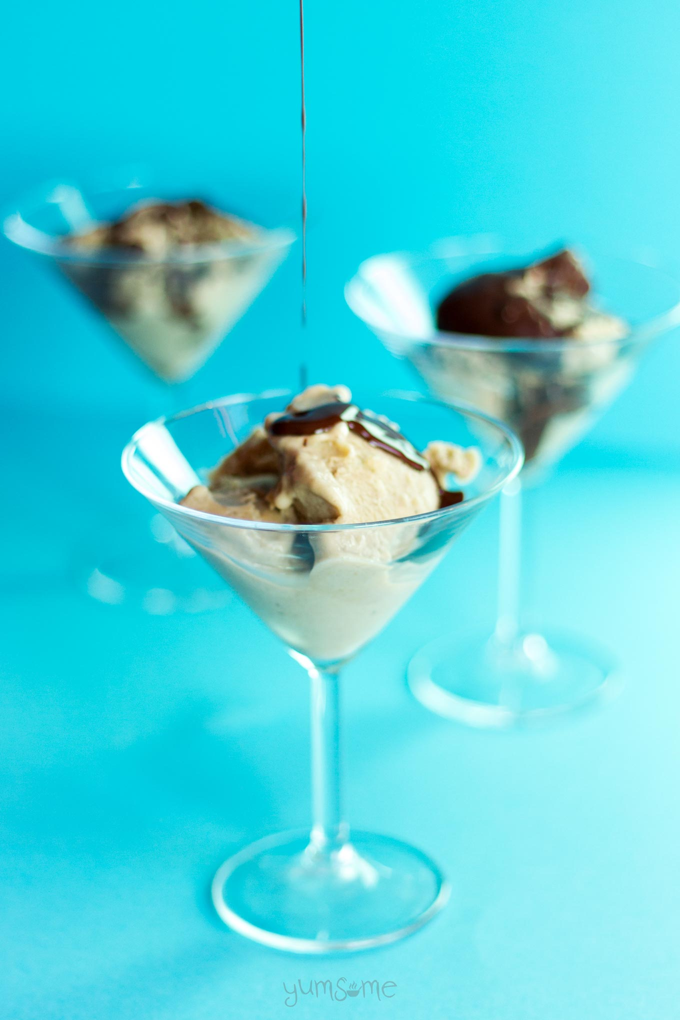 chocolate pouring over vegan banana and peanut butter ice cream   yumsome.com
