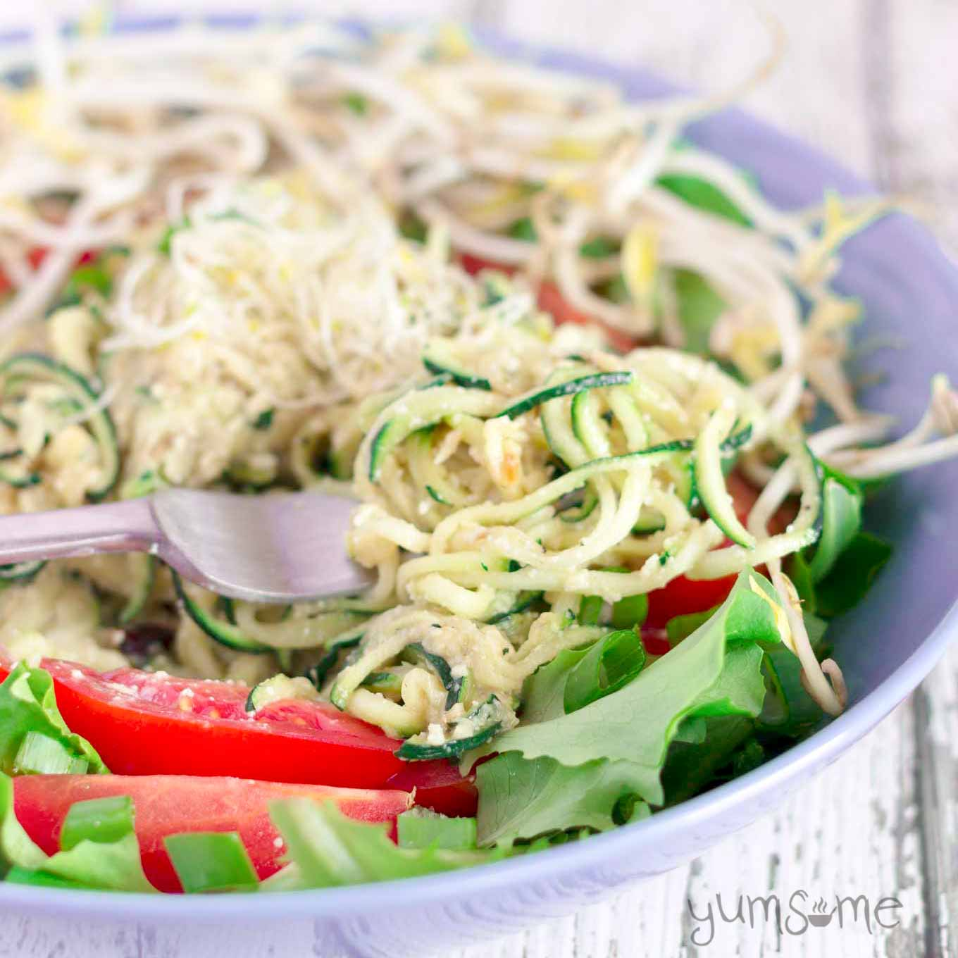 vegan zucchini noodles with parmesan and a green salad | yumsome.com