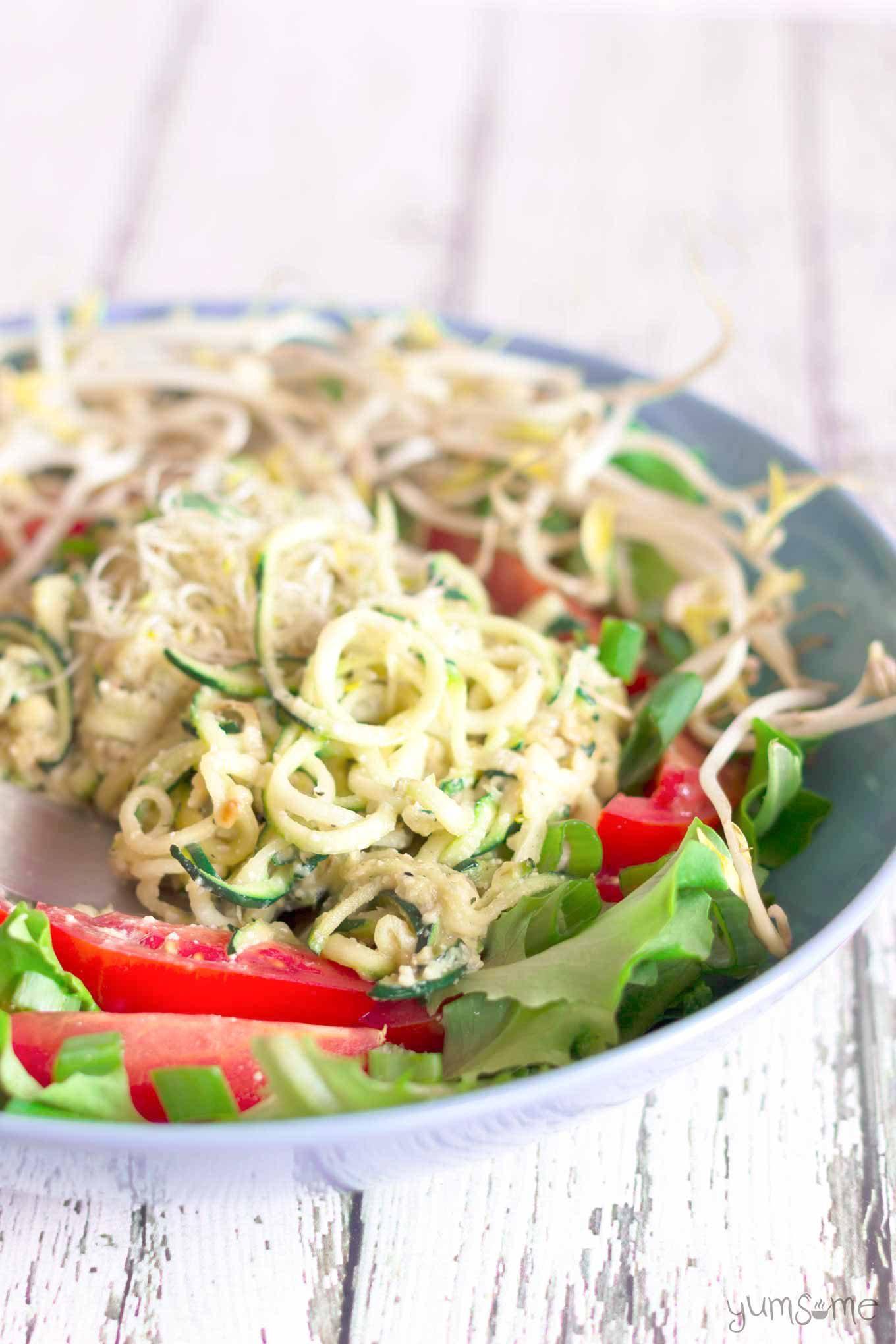 a bowl of vegan parmesan zucchini noodles | yumsome.com