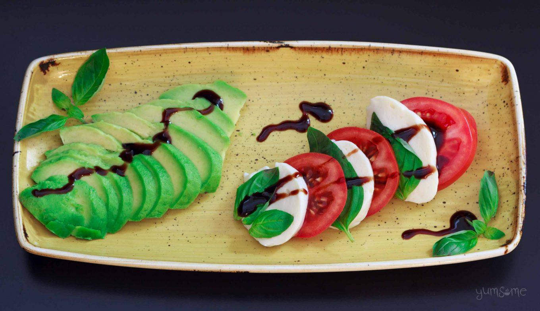 horizontal image of vegan caprese il tricolore with avocado | yumsome.com
