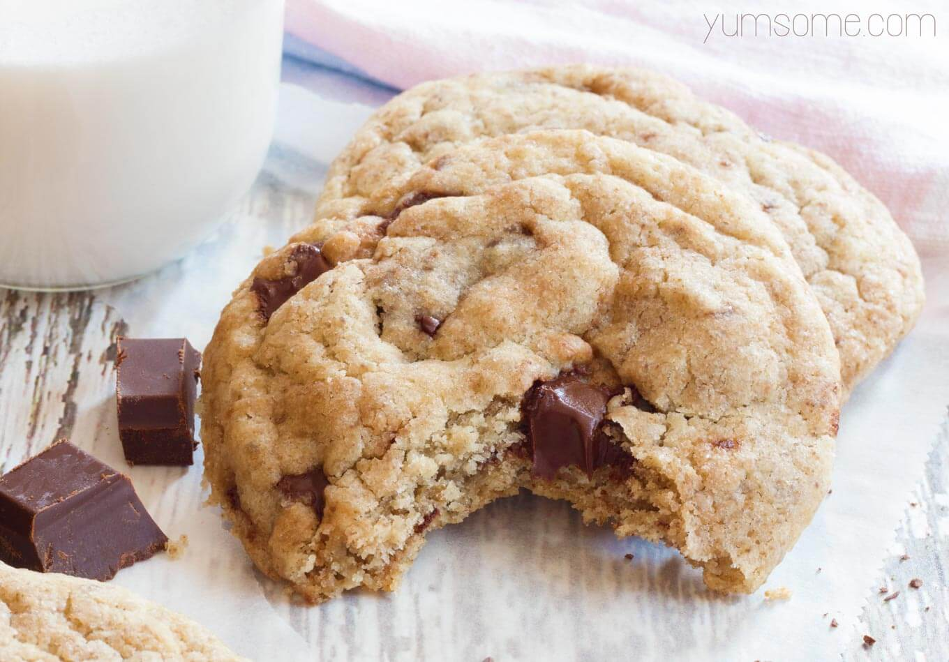 a bite from a vegan choc chunk cookie | yumsome.com