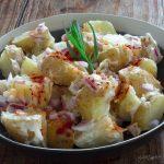 Close up of a bowl of potato salad.