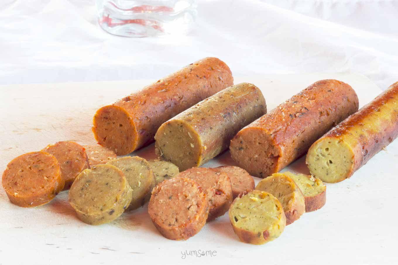 A row of various flavoured vegan sausages.