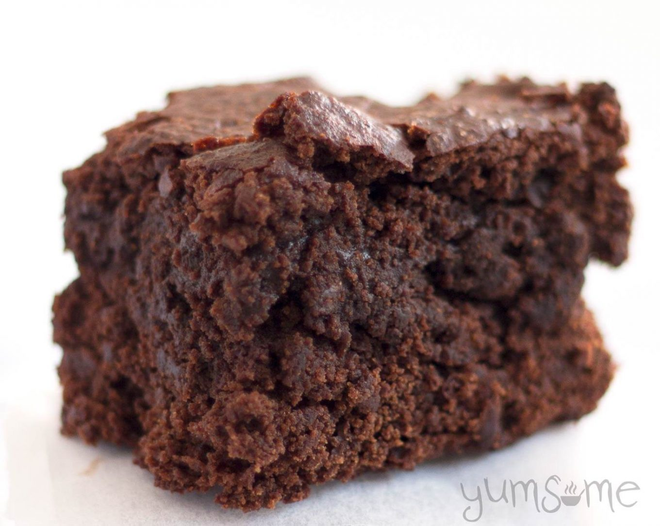 A vegan brownie on a white background.