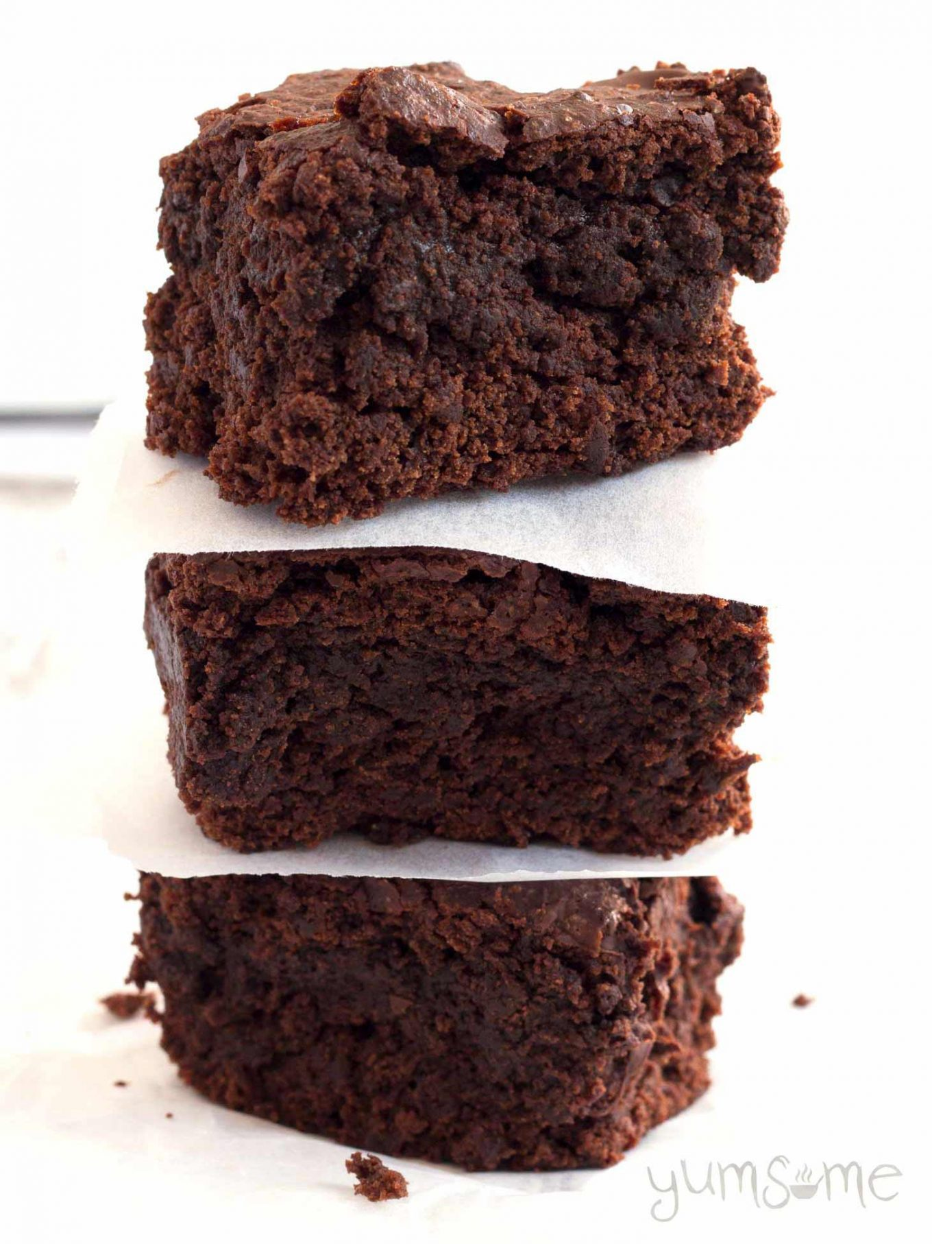 A stack of three perfect vegan brownies.
