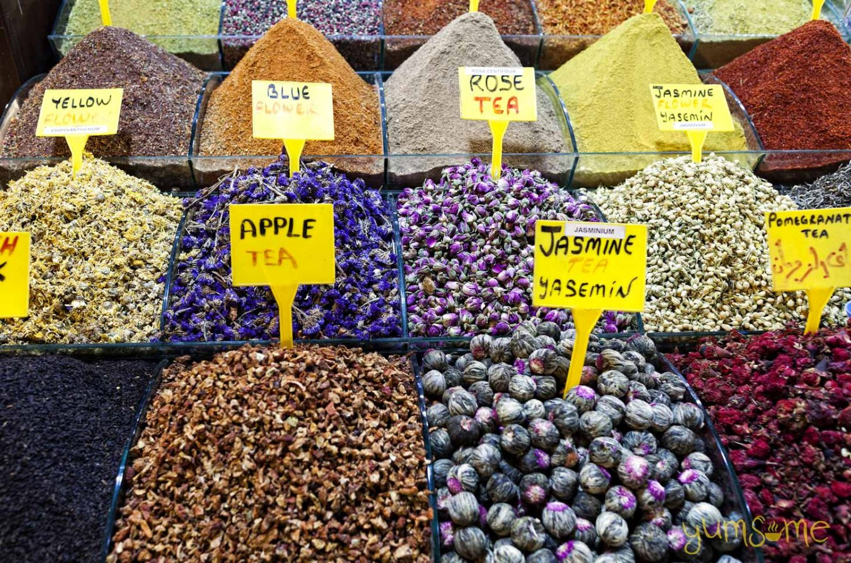 Bins of tea ingredients at a market in Turkey.