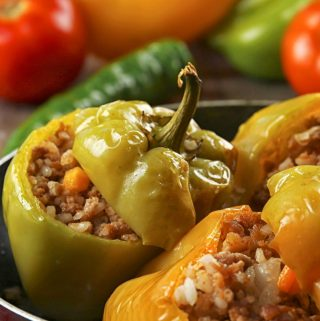 The sweetness of the peppers, the slightly spicy filling, the rich tomato gravy, and a mound of fluffy mashed potatoes - I tell you, it's Heaven on a plate! | yumsome.com