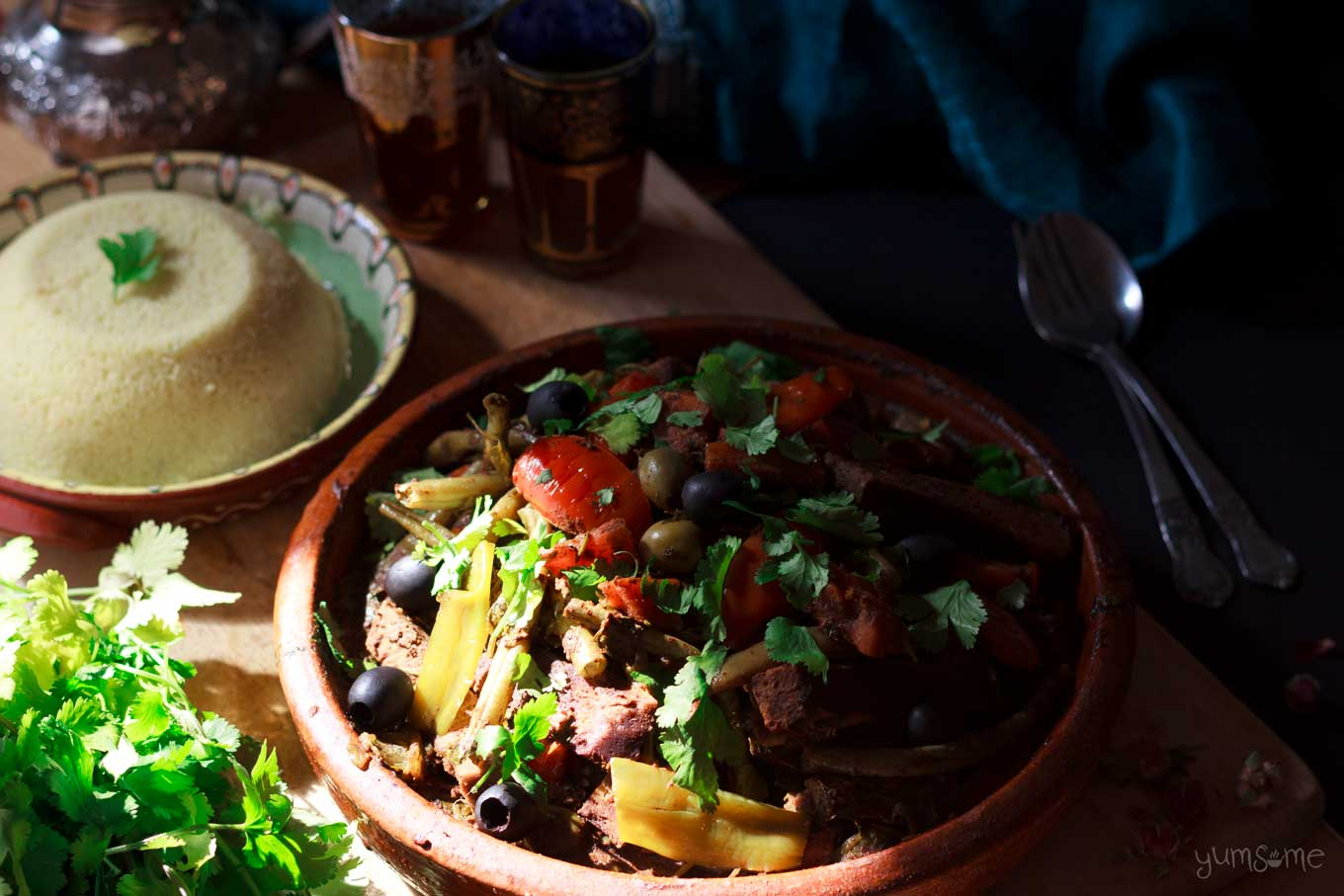 a dome of couscous with some moroccan vegetable tagine | yumsome.com