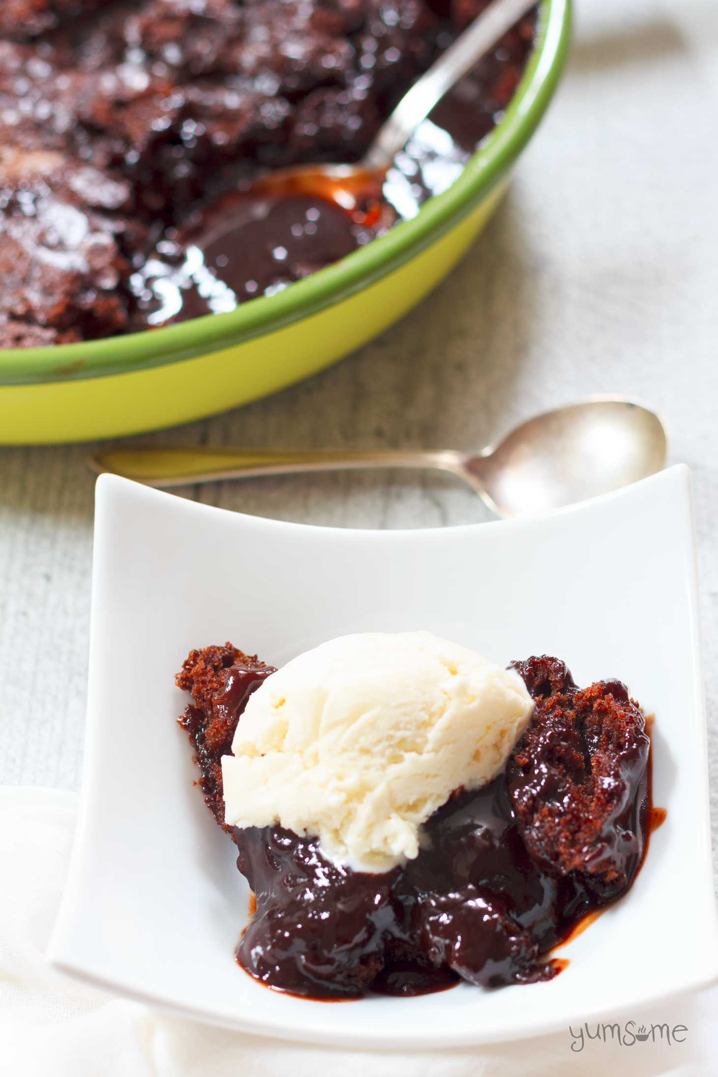 Vegan self-saucing chocolate pudding has a lovely moist, cakey, brownie-like, top part, with a rich velvety sauce hidden underneath. | yumsome.com