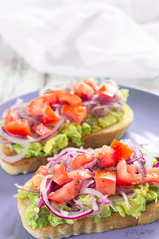 Two slices of avocado and tomato bruschetta | yumsome.com