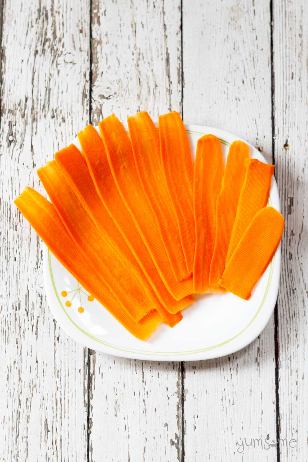 a plate of raw carrot slices | yumsome.com