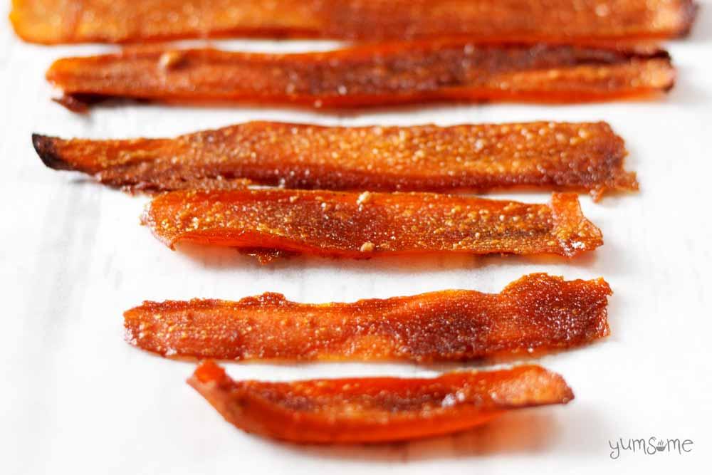 Vegan carrot bacon rashers on a white background.