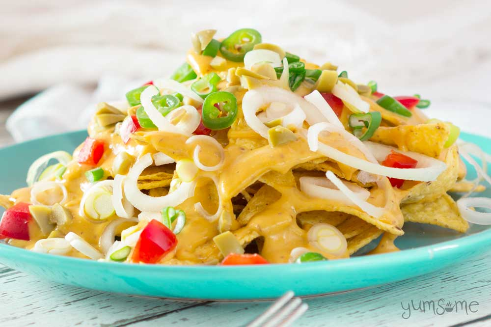 vegan nacho cheese drizzled over nacho cheese | yumsome.com