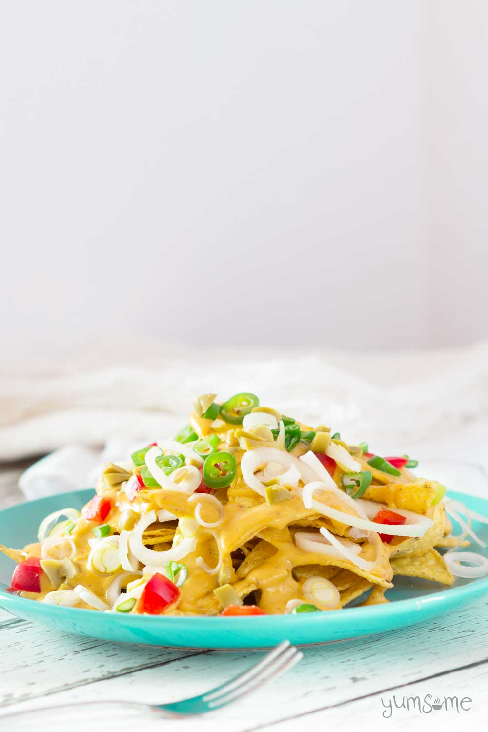 Made with just a handful of staple ingredients, my vegan nacho cheese is creamy and cheesy, with a little bit of a spicy kick.   yumsome.com