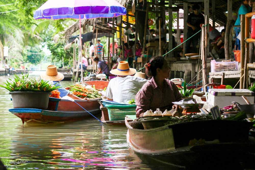A woman in a boat at Bangkok's floating market, Khlong Lat Mayom.