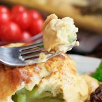closeup of a forkful of veganized cauliflower cheese | yumsome.com