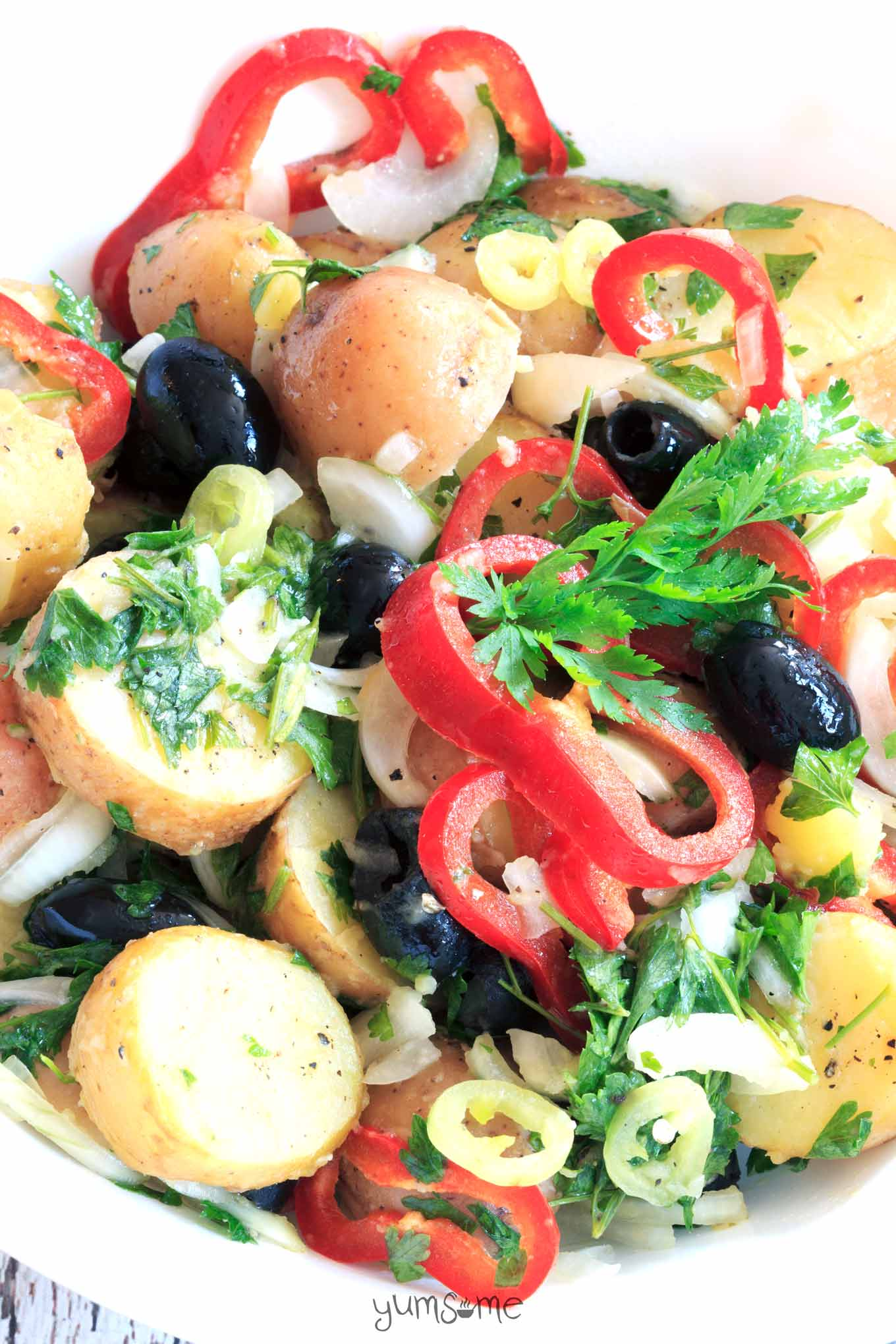 Great for parties and BBQs, this delicious loaded spring potato salad is full of goodness, and super-filling too.| yumsome.com