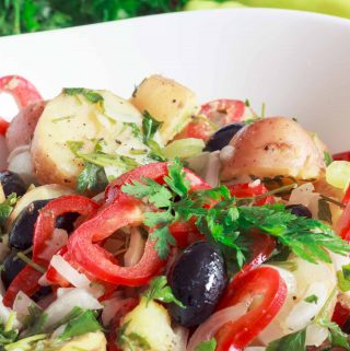 Simple and delicious, this loaded spring potato salad is bursting with veggies | yumsome.com