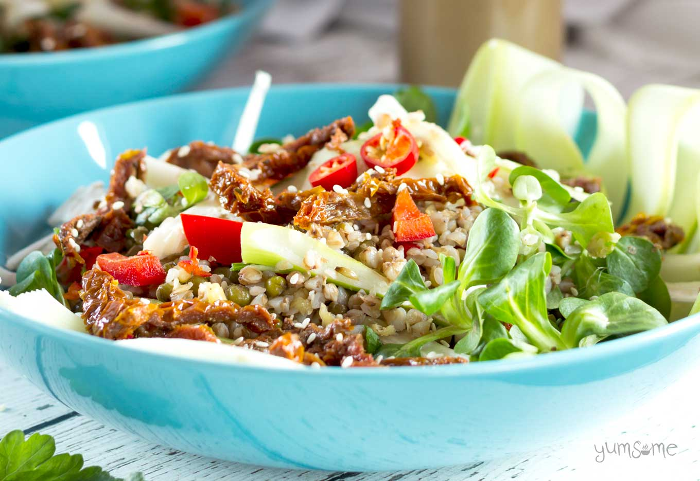 closeup view of a bowl of spicy buckwheat and mungbean salad | yumsome.com