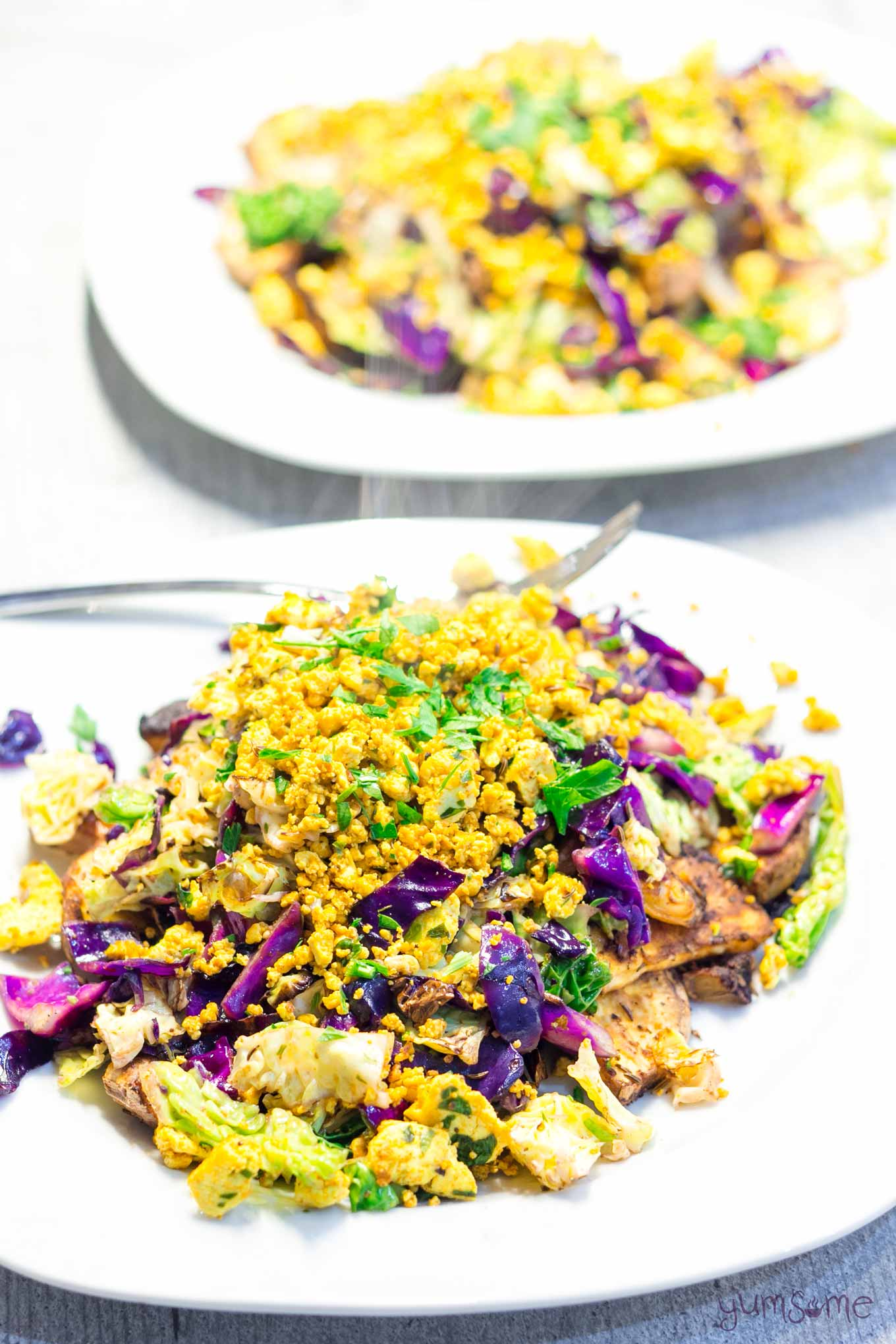 two plates of spicy tofu scramble | yumsome.com