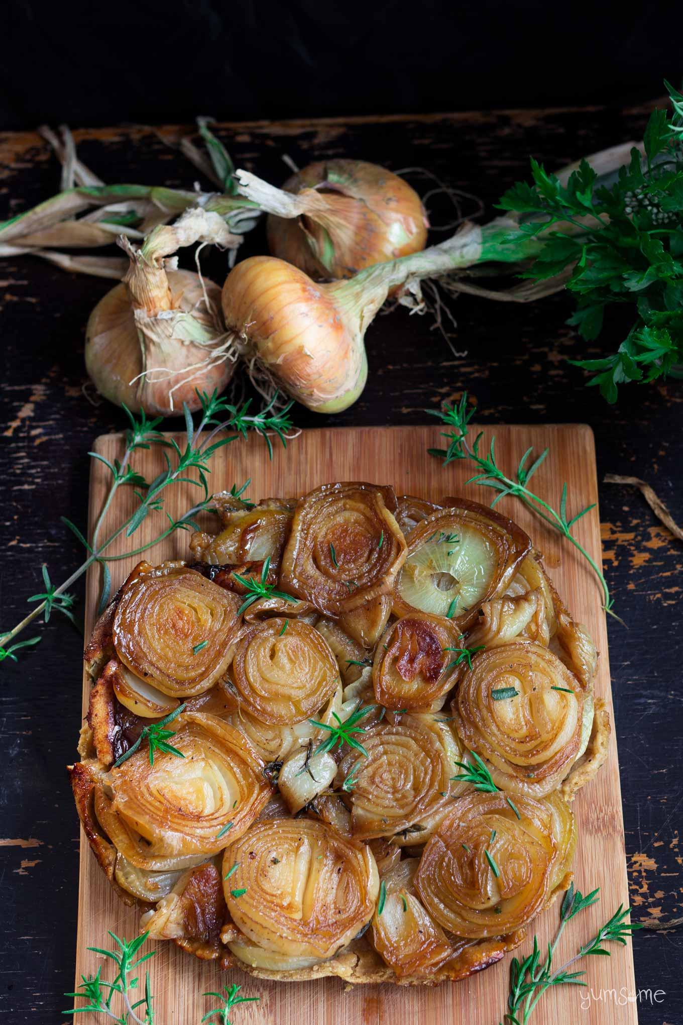 overhead view of caramelised onion tarte tatin   yumsome.com