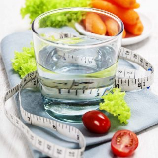 a glass of water, some fruit, and a tape measure | yumsome.com