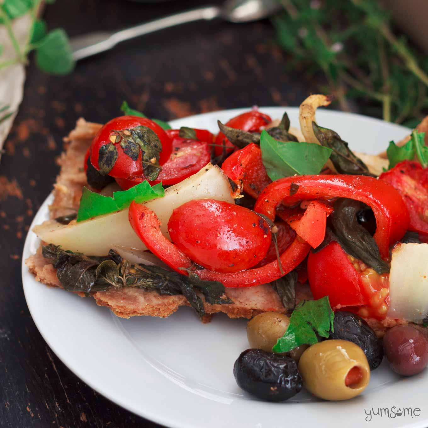 overhead view of a slice of Mediterranean Summer Vegetable Tart | yumsome.com