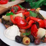 Close up of a slice of Mediterranean Summer Vegetable Tart with vegan lemon cashew ricotta.