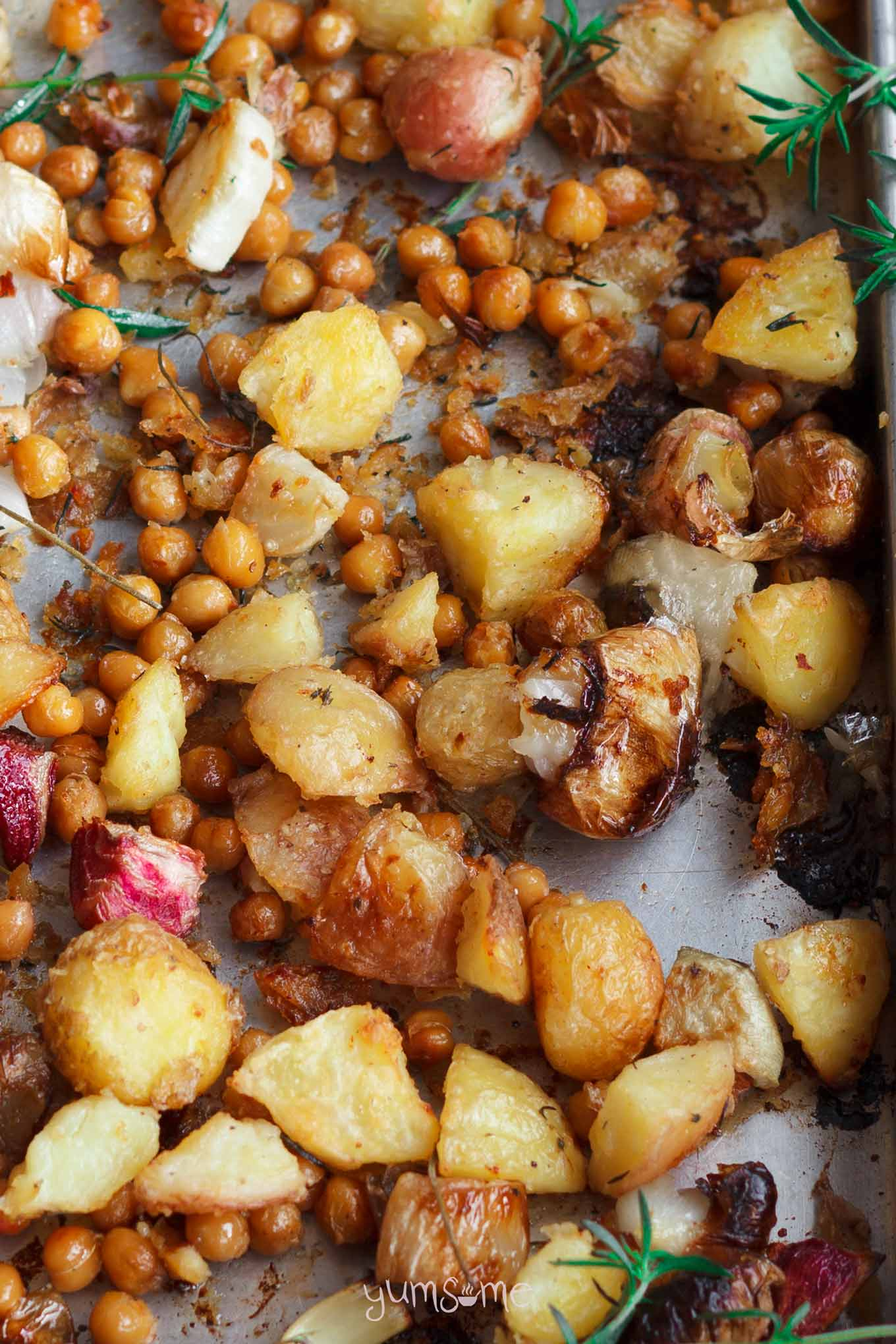 closeup of roast potatoes in a pan | yumsome.com