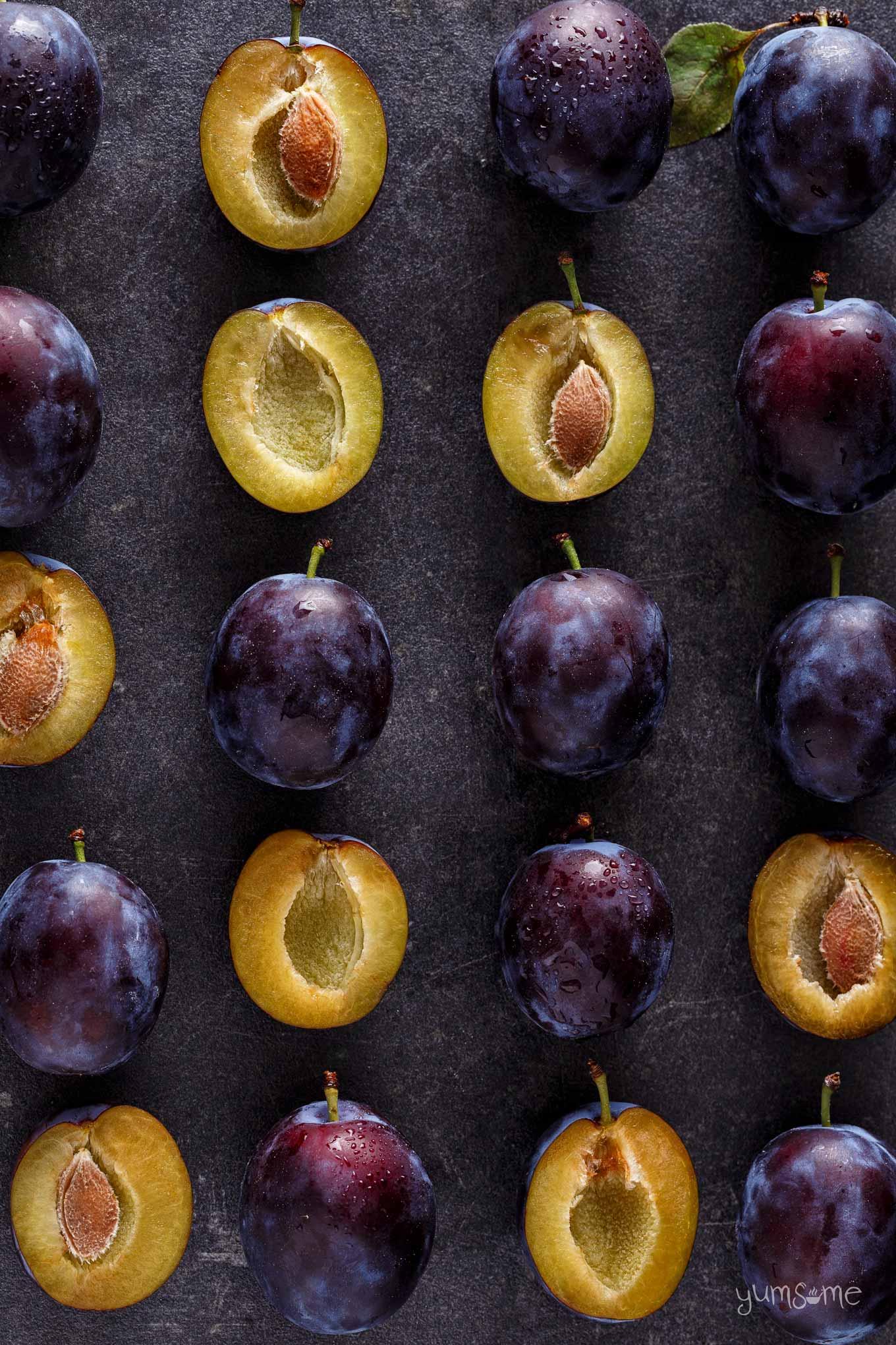 overhead shot of fresh plums on a slate | yumsome.com