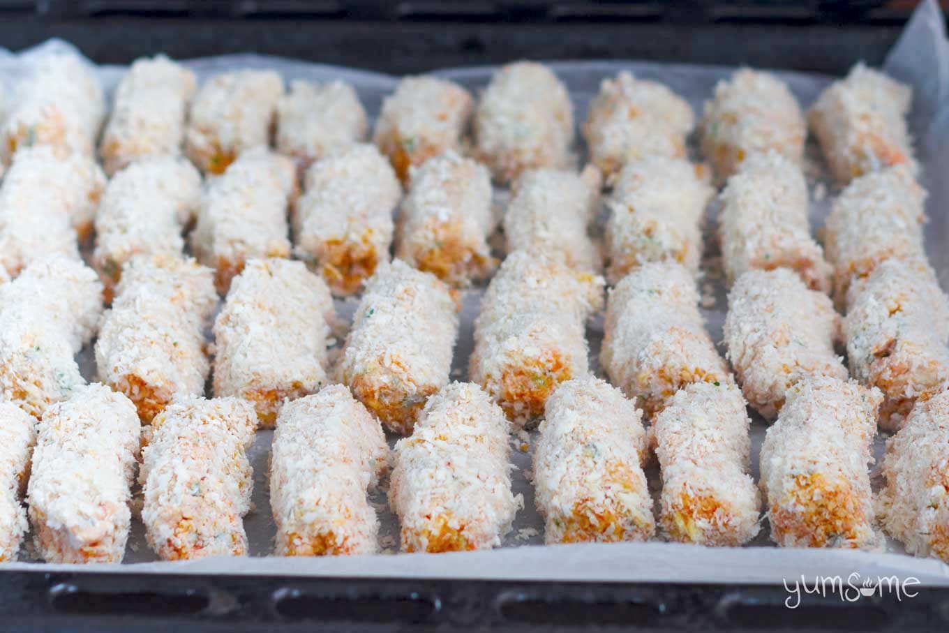 A tray of  unbaked pumpkin tots .