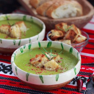 Two bowls of Quick 'n' Easy Piquant Pea & Leek Soup on a red cloth.