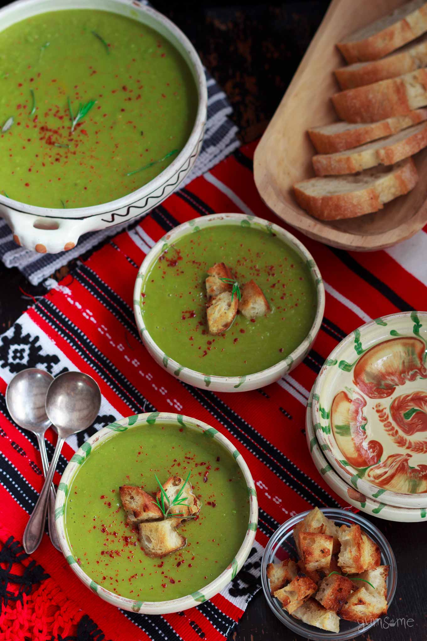 three bowls of Quick 'n' Easy Piquant Pea & Leek Soup on a table with bread   yumsome.com