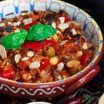 Closeup of Sicilian caponata in a colourful dish.