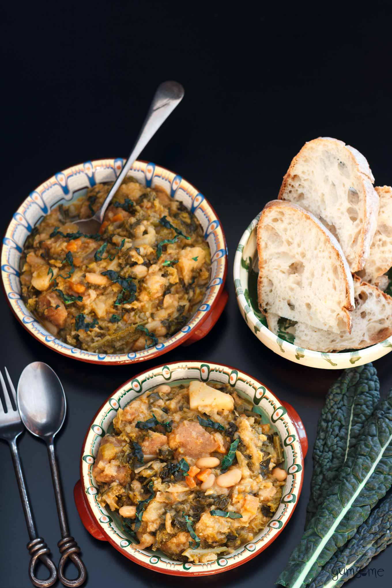 two dishes of ribollita (Tuscan bread soup), some bread, and some cavolo nero | yumsome.com