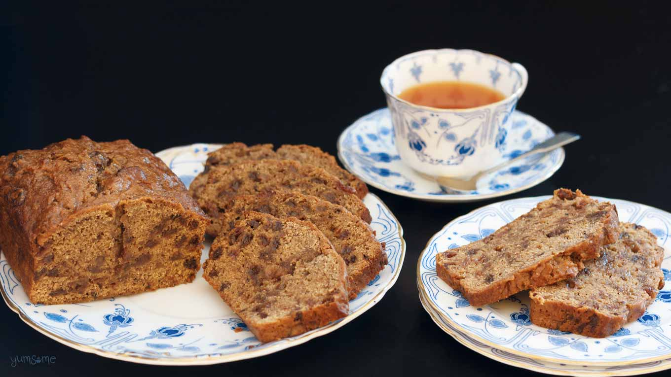 a cup of tea, plus two plates of vegan english tea loaf | yumsome.com
