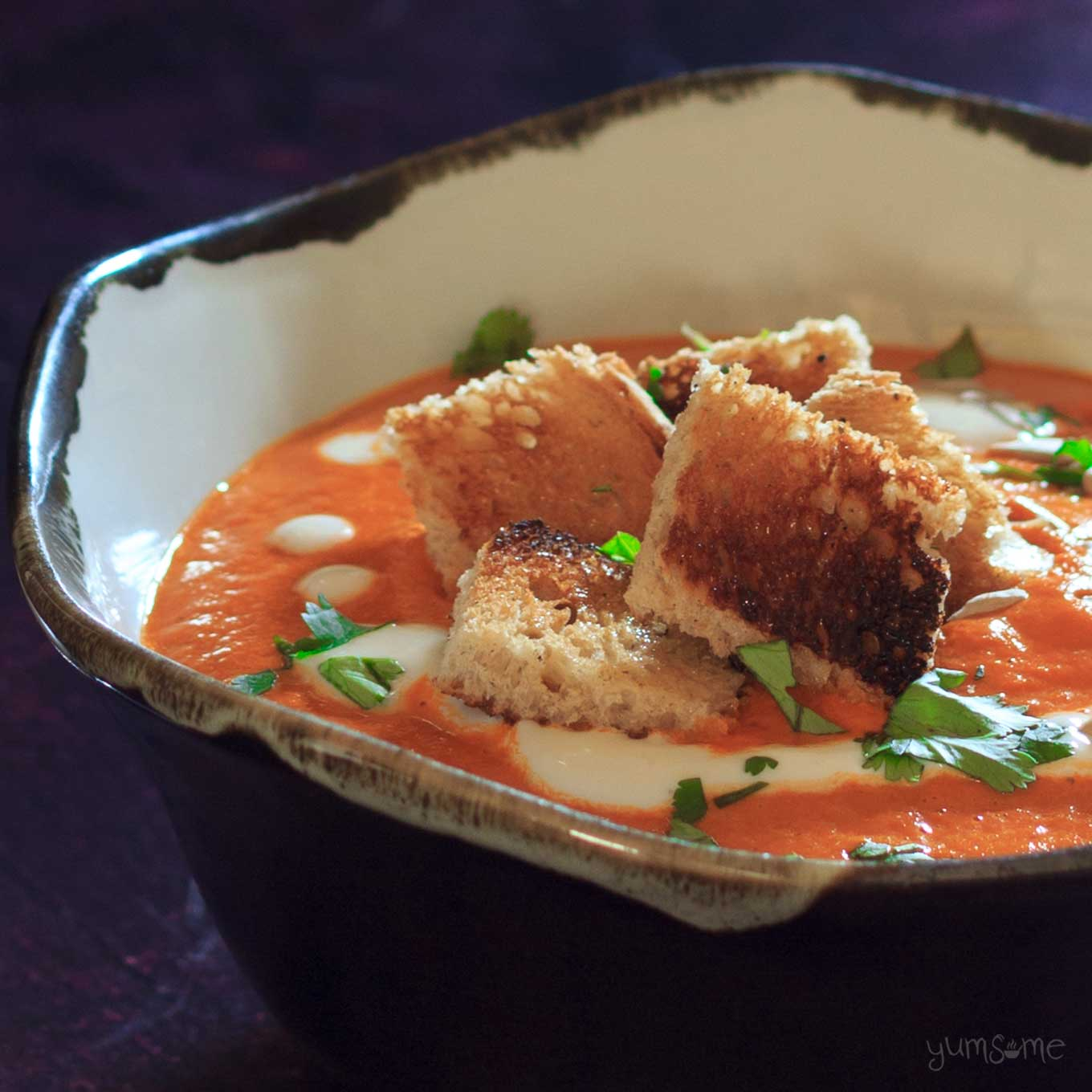 closeup of a bowl of Creamy vegan tomato bisque | yumsome.com
