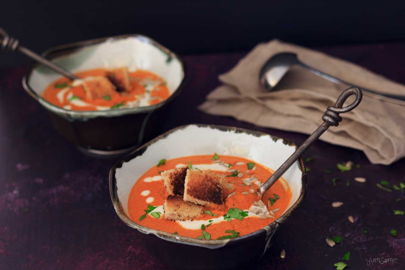 two bowls of Creamy vegan tomato bisque | yumsome.com