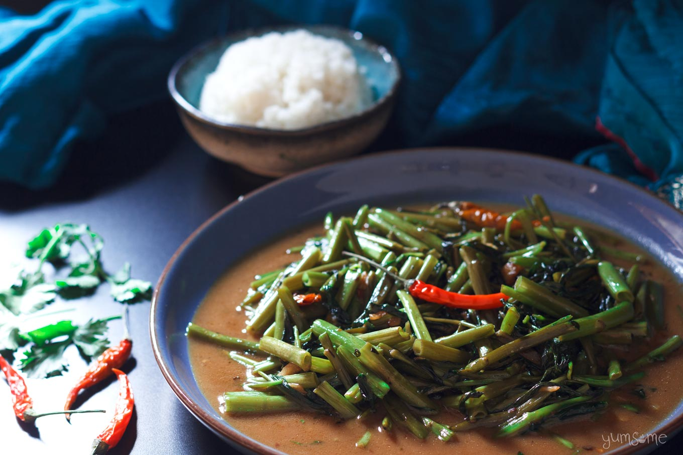 closeup of a plate of vegan Thai stir-fried morning glory | yumsome.com