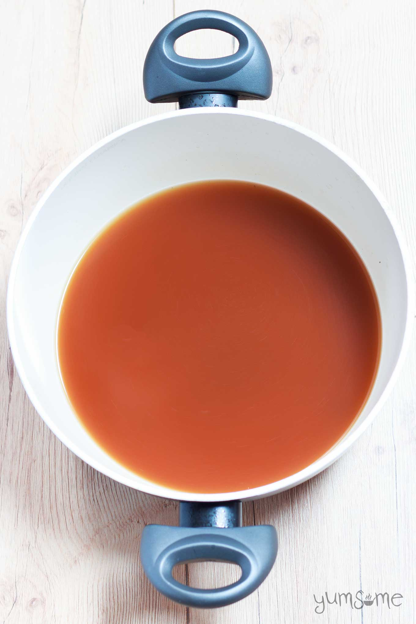 a pan of home-made vegetable broth | yumsome.com