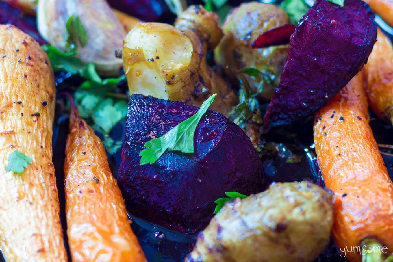 closeup of a tray of maple roasted root vegetables | yumsome.com