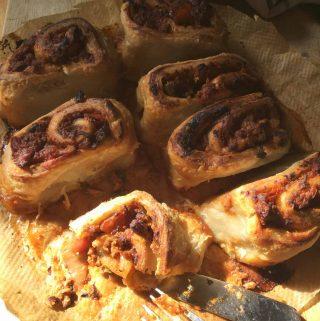 a partially eaten vegan bolognese roll | yumsome.com
