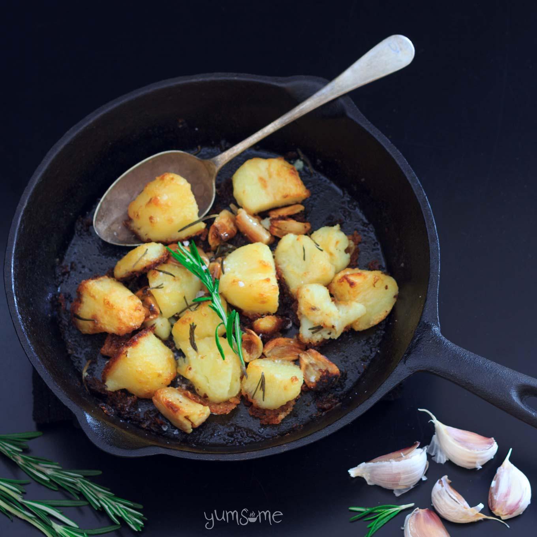 A cast iron skillet of vegan mayo-roast potatoes.