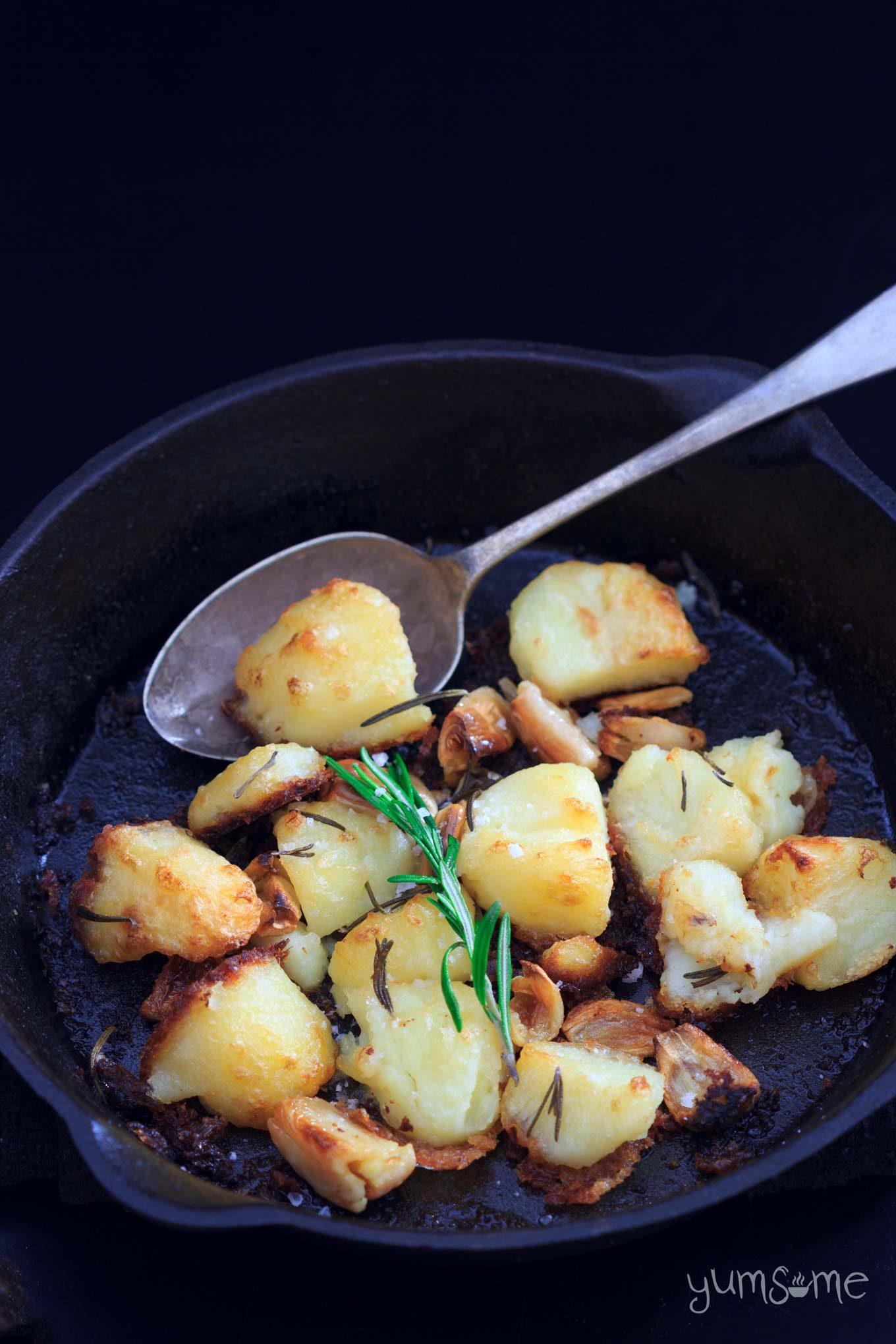 closeup of a skillet of vegan mayo-roast potatoes   yumsome.com