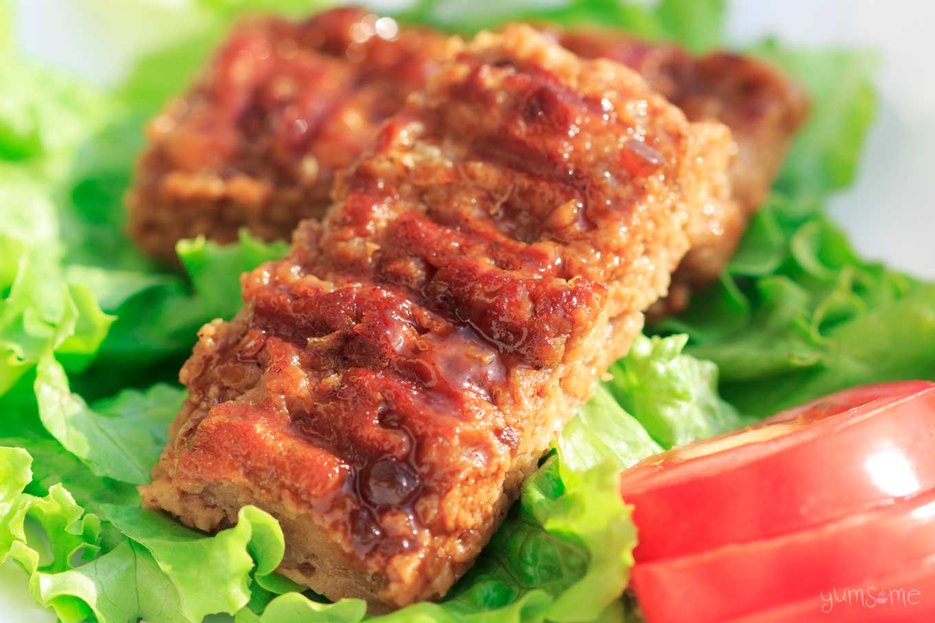 Vegan bbq ribs on a bed of lettuce..