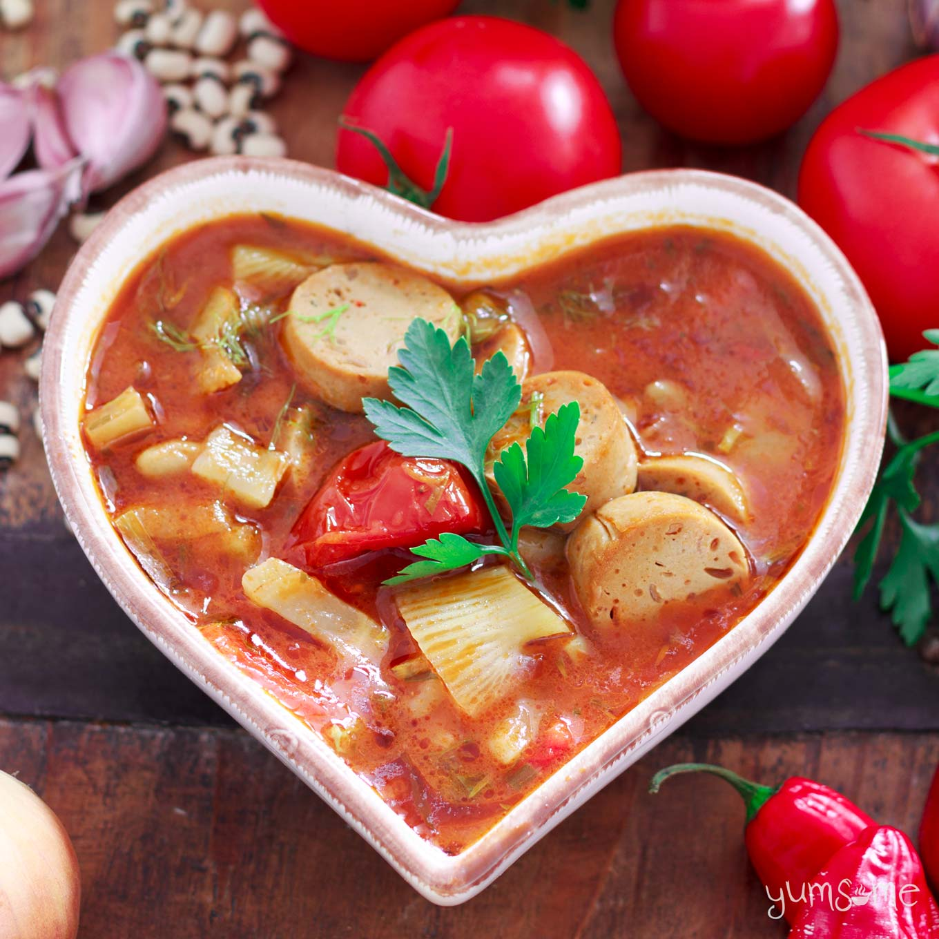 vegan sausage, fennel, and bean casserole in a heart-shaped bowl | yumsome.com