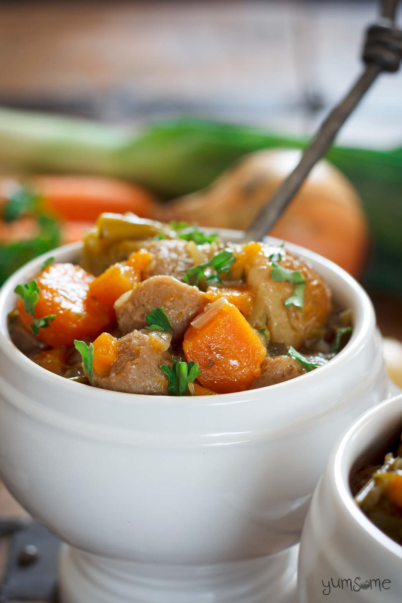 A white bowl containing vegan Irish stew.