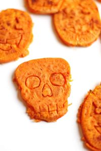 Slices of sweet potato cut into skull shapes.