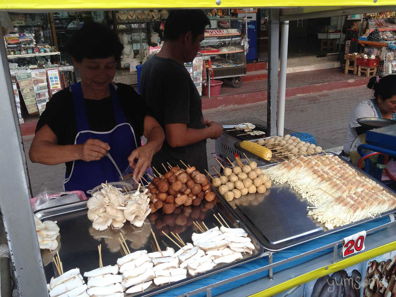 Mushrooms, tofu balls, and corn on the cob being sold from a street cart in Mae Sai, Thailand.