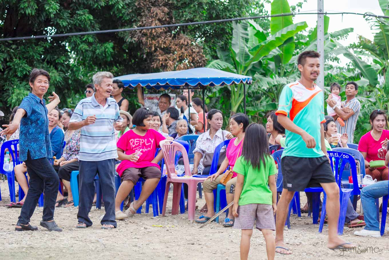 People dancing in a village in Thailand.
